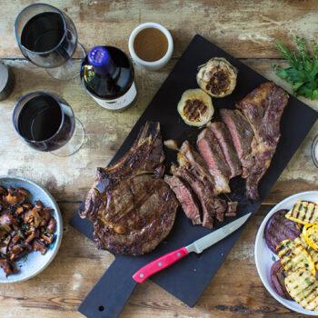 Steak, roasted veggies and wine