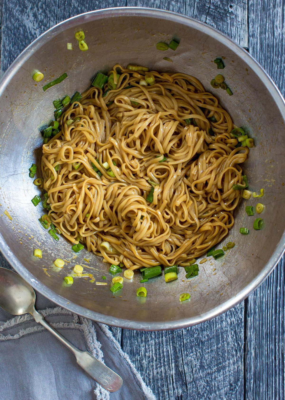 salmon sesame noodles in a bowl