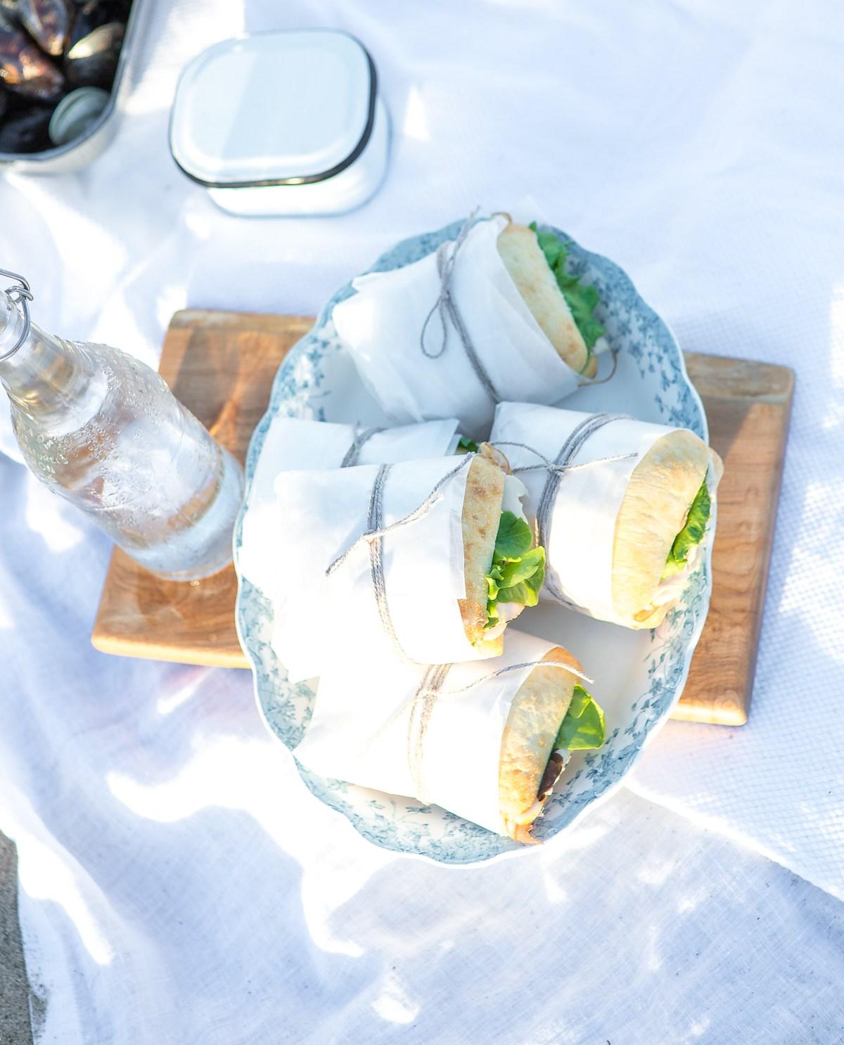 Beach picnic - sandwiches on a cutting board