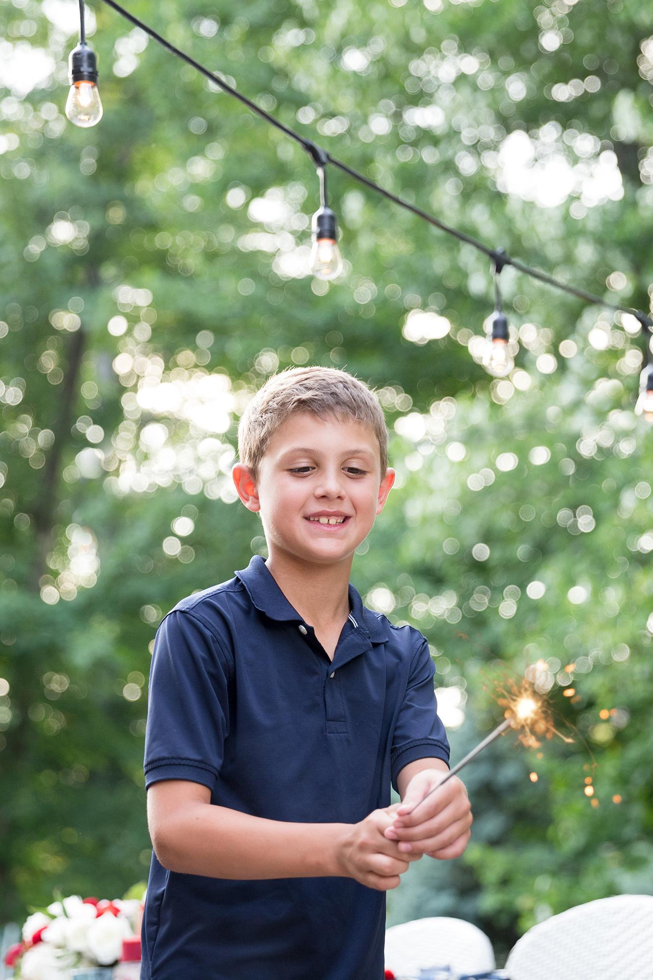 One Stylish Party - Boy holding a sparkler
