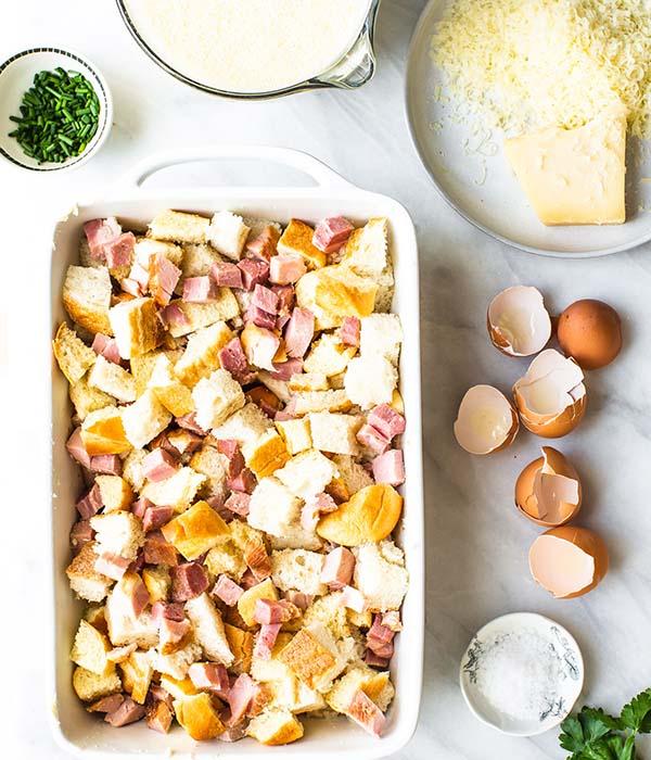 Easter Ham Strata Assembled in White Baking Dish