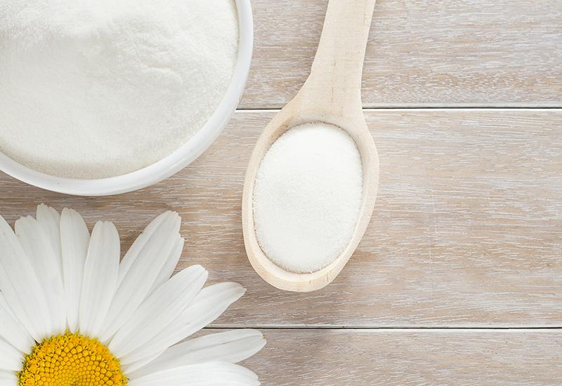 Collagen powder in a spoon