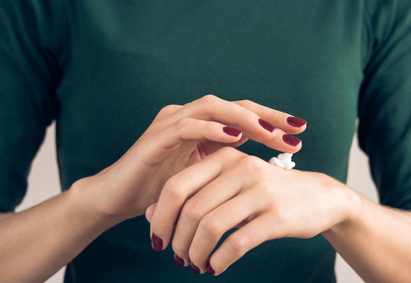 CBD lotion on woman's hand