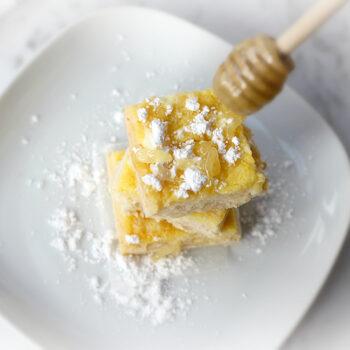 Manuka honey lemon bars on white plate