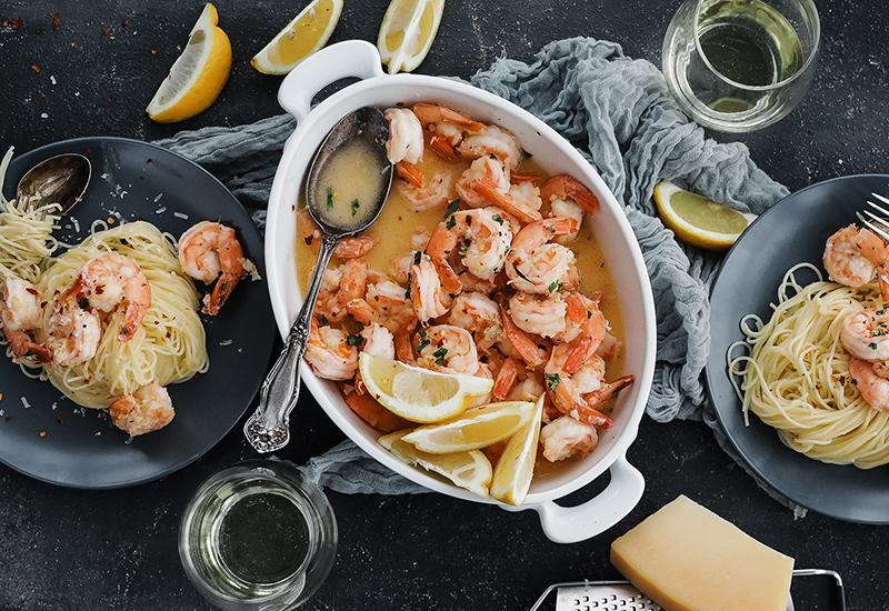 Shrimp scampi served over pasta