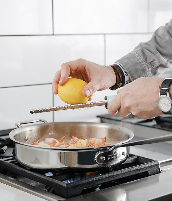 Shrimp in pan with lemon zest