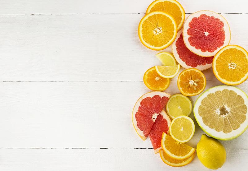Sliced citrus on white background