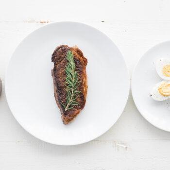 Steak, dressing and hard boiled eggs