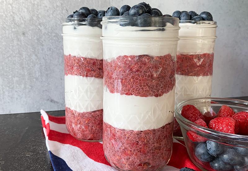 2 Patriotic Parfaits in Jars with a Bowl of Berries