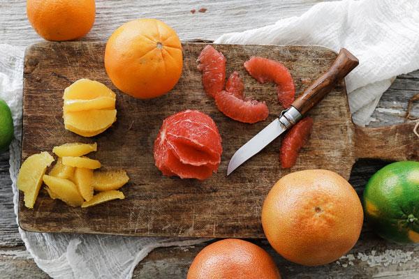 Segmented citrus on cutting board