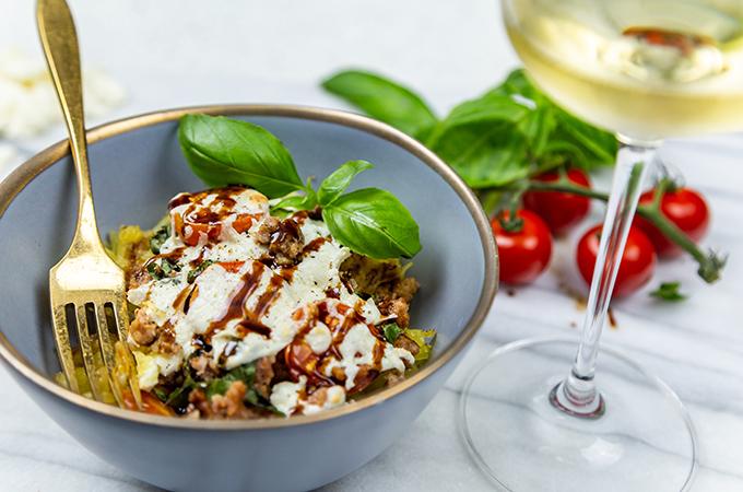 Italian Caprese Stuffed Spaghetti Squash In a Bowl